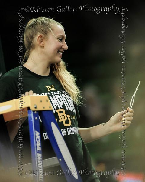 Lauren Cox shows the crowd her souvenir piece of the net.