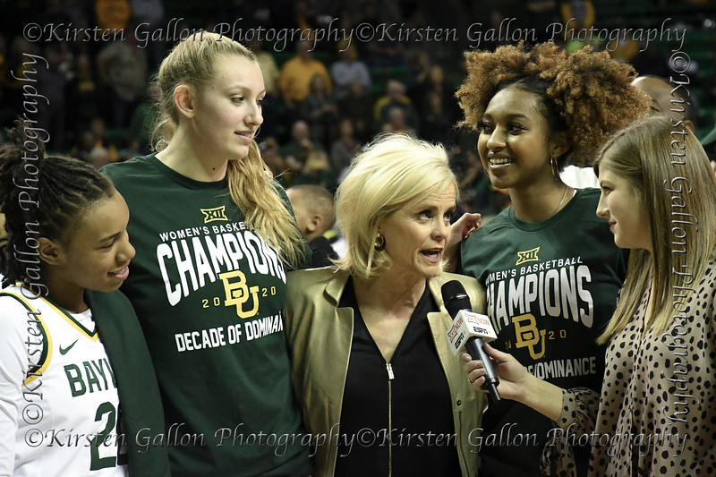 Juicy Landrum, Lauren Cox, and Didi Richards stand by as Coach Kim Mulkey gives a post game interview to Assoc Dir. of BaylorVision, Brooke Badnarz.