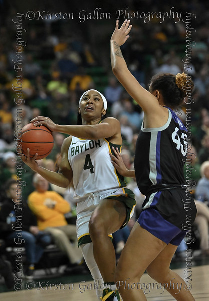 Baylor guard Te'a Cooper starts to make a lay-up getting past the defensive stance of #43 K State guard Christianna Carr.