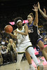 Baylor Forward NaLyssa Smith looks for a passing lane under the basket against the defense of K State Center Ayoka Lee.