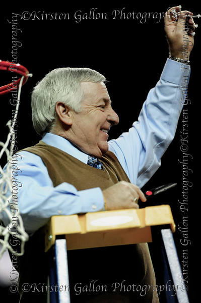 Johnny Derrick, Assistant AD/Operations, waves at the crowd with his piece of the net.