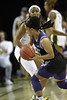 K State's Angela Harris looks to get a pass around the defensive stance of Baylor guard Te'a Cooper.