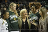 Juicy Landrum, Lauren Cox, and Didi Richards watch as Coach Kim Mulkey gives a post game interview with Assoc Dir. of BaylorVision, Brooke Badnarz.