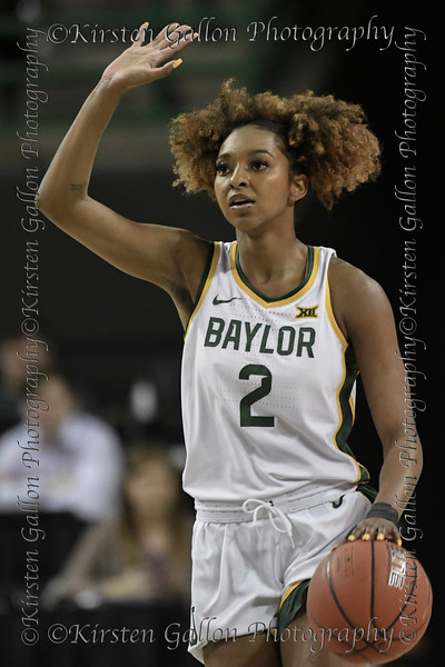 Baylor guard #2 Didi Richards signals a play as she brings the ball up the court.