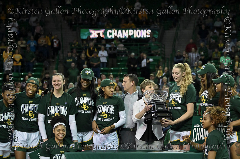 Big 12 Exec. Assoc. Comm. Dana Scherf presents Senior Baylor Center Lauren Cox with the Women's 2020 Big 12 Champion trophy.  From left are, Moon Ursin, Jordyn Oliver, Caitlin Bickle, Queen Egbo, Juicy Landrum, Athletic Director Mack Rhoades, Lauren Cox, Erin DeGrate, Te'a Cooper and on the left side of the table Trinity Oliver, on the right side, Didi Richards.