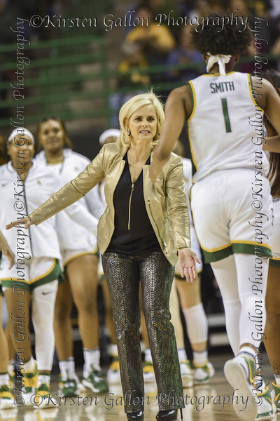 Coach Kim Mulkey goes in for the low five as NaLyssa Smith comes to the bench during a timeout.