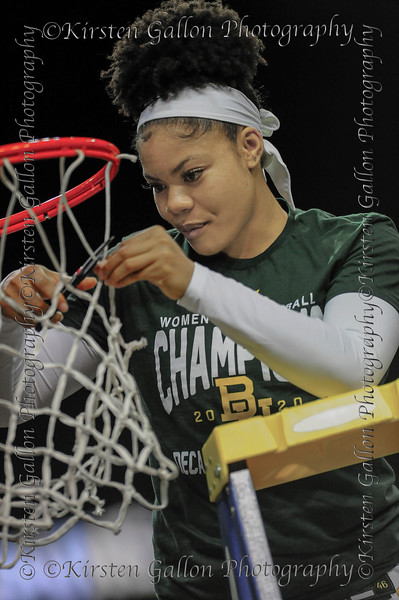 Trinity Oliver takes a turn at cutting the net.