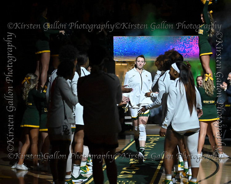 Baylor Center Lauren Cox is greeted by the rest of her teammates.