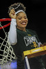 Trinity Oliver shows off her piece of the net to the crowd.