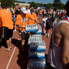 Record-Eagle/ Keith King<br /> Volunteers unload bottled water from a truck Saturday, May 29, 2010 on the track at Traverse City Central High School during the Traverse City State Bank Bayshore Marathon, Half Marathon and 10K.