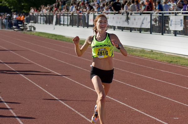 Record-Eagle/ Keith King<br /> Andrea Pomaranski, of Farmington, wins first place in the womens division of the Traverse City State Bank Bayshore Half Marathon Saturday, May 29, 2010.