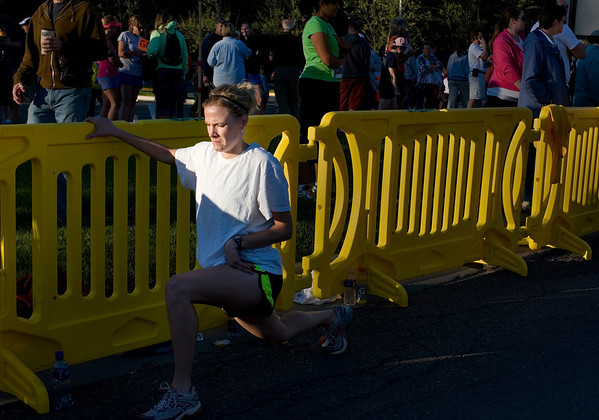 Record-Eagle/ Keith King<br /> Lynnelle Rehkopf, of Grand Rapids, stretches prior to the start of the Traverse City State Bank Bayshore 10K.
