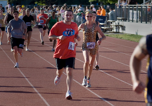 Record-Eagle/ Keith King<br /> Michelle Dvorak, of Burton, finishes the Traverse City State Bank Bayshore 10K Saturday, May 29, 2010 wearing a leopard-print outfit.