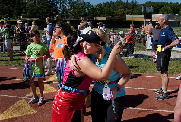 Record-Eagle/ Keith King<br /> Marcia Van Essen, right, and Lisa Kunecki, left, both of Grand Rapids, congratulate each other Saturday, May 29, 2010 after both finished the Traverse City State Bank Bayshore Half Marathon.