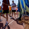 Record-Eagle/ Keith King<br /> Medals for the Traverse City State Bank Bayshore Half Marathon hang from a volunteer's arm Saturday, May 29, 2010 prior to being handed to runners at the finish on the track at the Traverse City Central High School.
