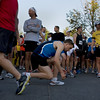 Record-Eagle/ Keith King<br /> Chad Connor, of Dayton, OH, middle, ties his shoes Saturday, May 29, 2010 as he prepares for the start of the Traverse City State Bank Bayshore Marathon.