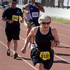 Record-Eagle/ Keith King<br /> Janet Weiler, 74, of Empire, crosses the finish line Saturday, May 29, 2010 after running in the Traverse City State Bank Bayshore Half Marathon.