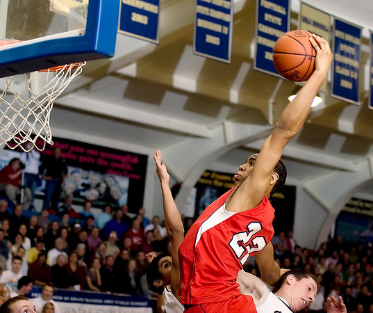 Record-Eagle/Keith King<br /> Suttons Bay's Dwaun Anderson leaps for a first-half dunk against Traverse City St. Francis Friday, December 10, 2010 at Traverse City St. Francis High School.