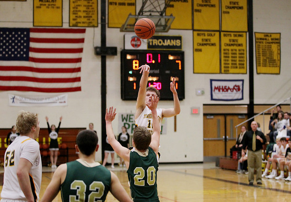 Record-Eagle/Keith King<br /> Traverse City Central's Taylor Cook shoots the ball and makes it at the end of the first quarter against Traverse City West Thursday, January 17, 2013 at Traverse City Central High School.