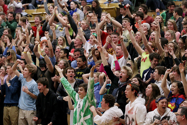 Record-Eagle/Keith King<br /> The Traverse City West student section cheers during the boys basketball game against Traverse City Central Thursday, January 17, 2013 at Traverse City Central High School.