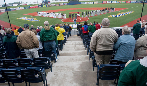 Record-Eagle/Douglas Tesner<br /> Fans and players stand for the National Anthem at the start of the Beach Bums home opener Tuesday.