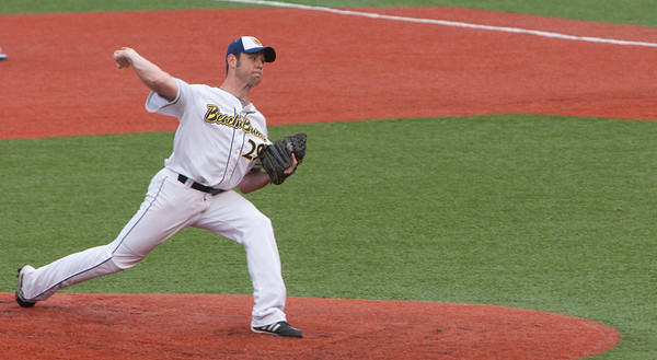 Record-Eagle/Douglas Tesner<br /> Traverse City's Steve Roberts delivers a pitch in the team's home opener Tuesday.