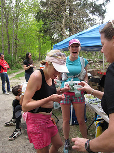 TNT athlete Mary Harvey (blue shirt, big smile) pacing her friend in the 50 mile race