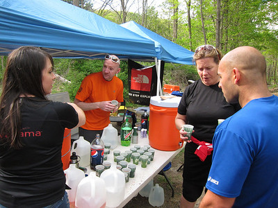 "Katie, Bill, Connie helping an athlete decide which beverage would be best.  Connie: ""Try the Gu Brew, it's been very popular today"" :-)"