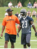 Head coach Lovie Smith talking with rookie return specialist Devin Hester