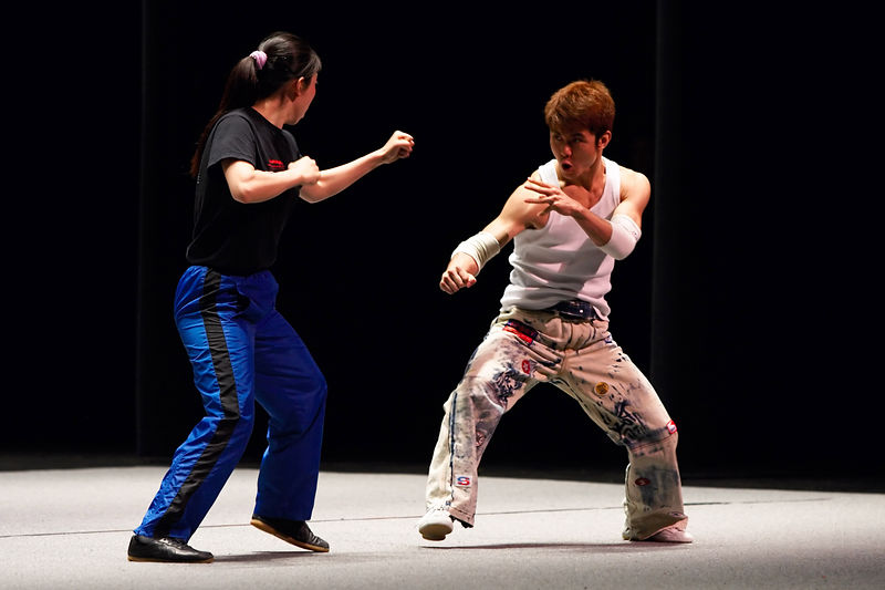 Fu Yang faces off against Shi Kun during the Beijing Wushu Team performance on November 18, 2005, at De Anza College's Flint Center in Cupertino.