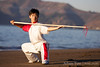 Wu Di and his spear at Baker Beach in San Francisco.