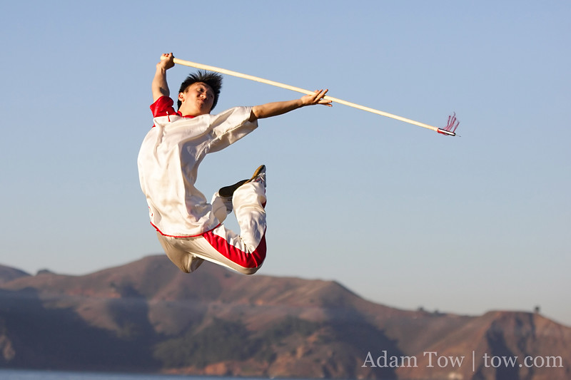 Wu Di jumps high in the air with his spear.