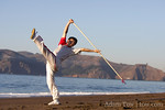 Wu Di performs his spear move at Baker Beach in San Francsico.