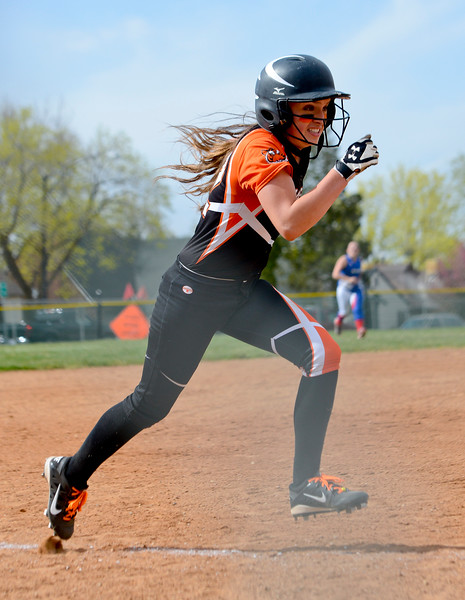 Margaret Kellly # 12 makes a dash for home plate against Ben Lomond High School. At Ogden High School on April 7, 2015.