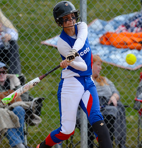 Emilee Roybal # 13 takes a swing at the ball against Ogden High School. At Ogden High School on April 7, 2015.