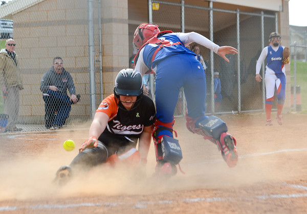 Ogden High's Katelyn Flunt # 8 slides into home as catcher Emilee Roybal tries to tag her out. At Ogden High School on April 7, 2015.