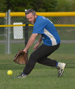 Lee Smith scoops up a ground ball in the outfield for the Benchwarmers. (Paula Roberts photo)