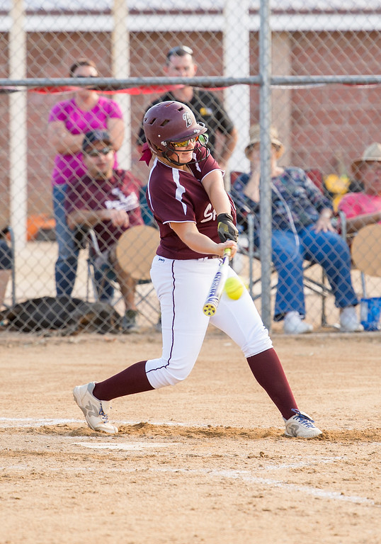 . Berthoud\'s Sarah Jorissen (25) drives a Frederick pitch into deep left field for a double Thursday afternoon Sept. 29, 2016 as the two teams met in Berthoud. (Photo by Michael Brian/Loveland Reporter-Herald)