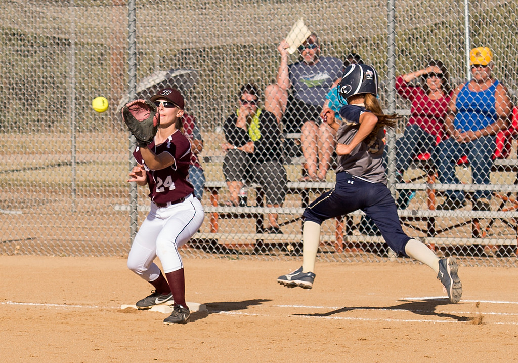 . Berthoud first baseman Morgan Schachterle (24) reaches for a succesful putout throw on Frederick\'s Brittie Massey (2) Thursday afternoon Sept. 29, 2016. (Photo by Michael Brian/Loveland Reporter-Herald)