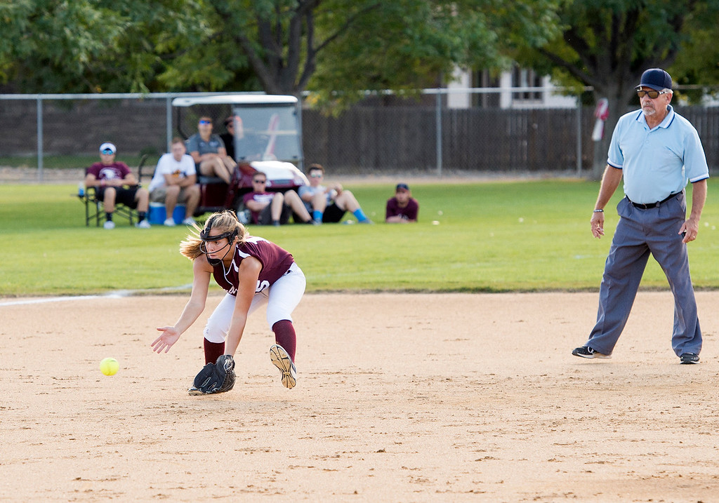 . Berthoud shortstop Addison Spears (15) reaches for a Frederick base hit Thursday afternoon Sept. 29, 2016 at the Spartans home field in Berthoud. (Photo by Michael Brian/Loveland Reporter-Herald)