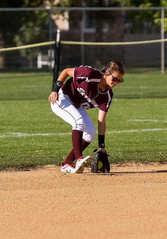 . Berthoud center fielder Sotera Dageenakis (00) scoops up a Frederick base hit Thursday afternoon Sept. 29, 2016 as the two teams met in Berthoud. (Photo by Michael Brian/Loveland Reporter-Herald)