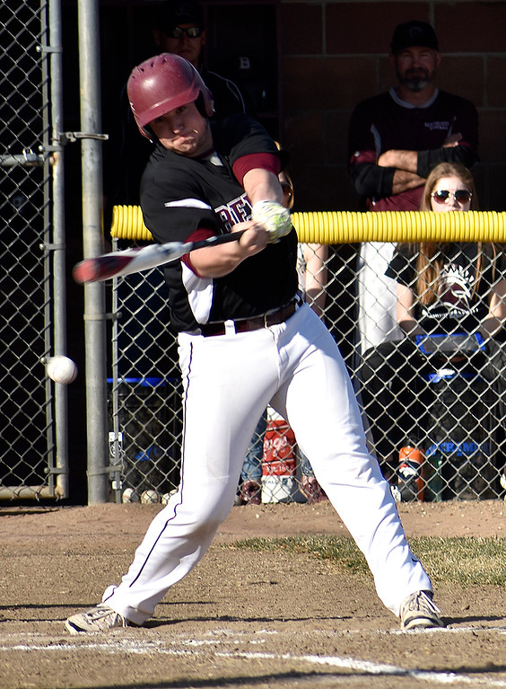 . Berthoud\'s (23) Connor Balliet takes a swing at the ball from D\'Evelyn during their game on Tuesday, March 13, 2018 at Berthoud High School in Berthoud. Photo by Thieng Mai/Loveland Reporter-Herald.