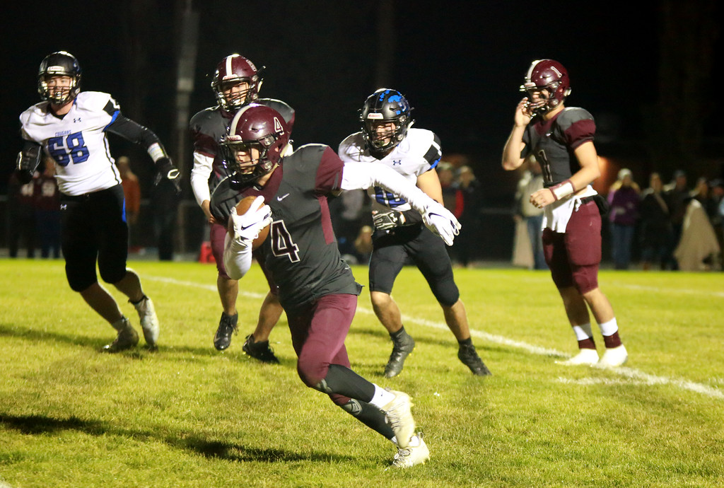 . Berthoud\'s (4) Austyn Binkly runs with the ball as Resurection Christian\'s (68) Sawyer Sheperd and (10) Peter Kuppinger follow while Bethoud\'s (1) Jake Lozinsky and (54) Zack Starkey follow their teammate at their game at Berthoud High School on Sept. 28, 21018 in Berthoud. Photo by Taelyn Livingston/ Loveland Reporter-Herald