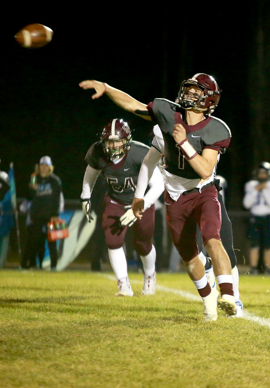 . Berthoud\'s (1) Jake Lozinksi makes a throw as teammate (54) Zak Starkey goes to defend him at their game at Berthoud High School on Sept. 28, 21018 in Berthoud. Photo by Taelyn Livingston/ Loveland Reporter-Herald
