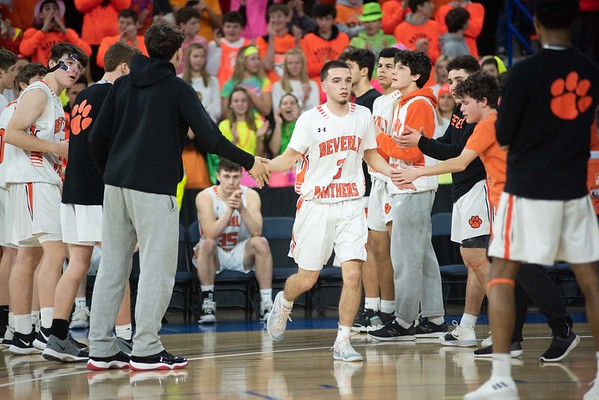 Beverly's Damian Bouras is greeted by teammates before the division 2 championship game. Beverly took on Belmont during the Division 2 North championship at the Tsongas Center in Lowell Saturday. Beverly took home the North Sectional trophy, with a final score of 76-59. RYAN MCBRIDE/Staff photo 3/7/20