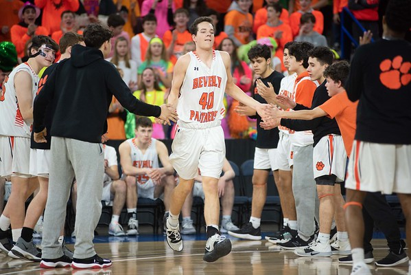 Beverly's Austin Ayer is greeted by teammates before the division 2 championship game. Beverly took on Belmont during the Division 2 North championship at the Tsongas Center in Lowell Saturday. Beverly took home the North Sectional trophy, with a final score of 76-59. RYAN MCBRIDE/Staff photo 3/7/20