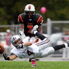 Beverly junior linebacker Peter Mulumba (7) closes in to try and disrupt Lynn English senior wide receiver CJ Hernandez (4) as he lays out to try and catch a pass over the middle. DAVID LE/Staff photo. 10/18/14.