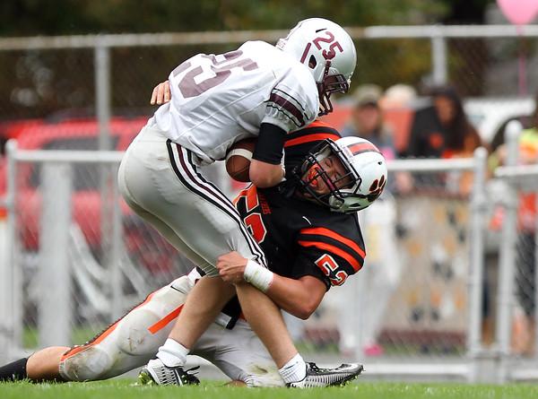 Beverly junior linebacker Sean Kalivas (52) drags down Lynn English sophomore running back Jonathan Kosmas (25). DAVID LE/Staff photo. 10/18/14.