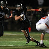 Marblehead senior captain Spencer Craig (3) scrambles out of the pocket and upfield against Beverly on Friday evening. DAVID LE/Staff photo. 10/10/14.