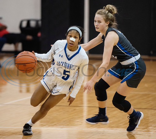 Jacksonville's Alexis Calderon (5) dribbles away  from Sulphur Springs' Addison Wall (2) during the first half of their bi-district playoff basketball game held at Wagstaff Gymnasium in Tyler on Monday, Feb. 17, 2020.  (Sarah A. Miller/Tyler Morning Telegraph)